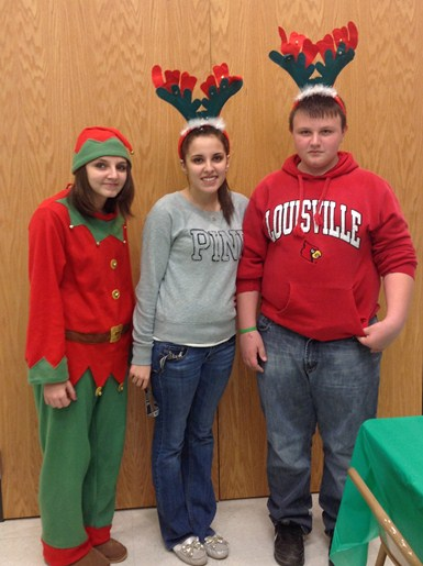 Brooklyn Green, Savannah Green, and Freddy Grubbs at the Autism Christmas party